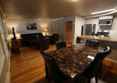 Photo of Dining Room with a view of the Living Room in the West Seattle Men's Sober Living Facility