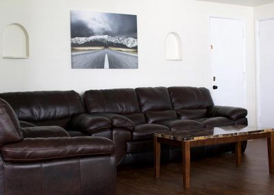 Photo of Living Room with comfy couch in the West Seattle Men's Sober Living Facility