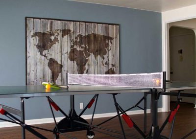 Photo of an indoor Ping pong table at the West Seattle Men's Sober Living Facility