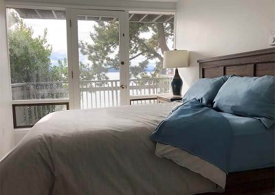 Seattle Sober Living Women - Bedroom with balcony and water view