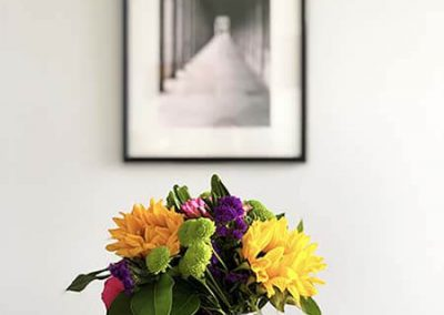 Seattle Sober Living Women - Vase of flowers on a wooden table